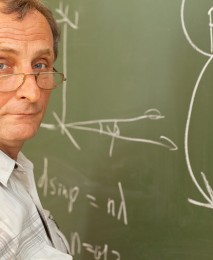Scientist solves equation on blackboard